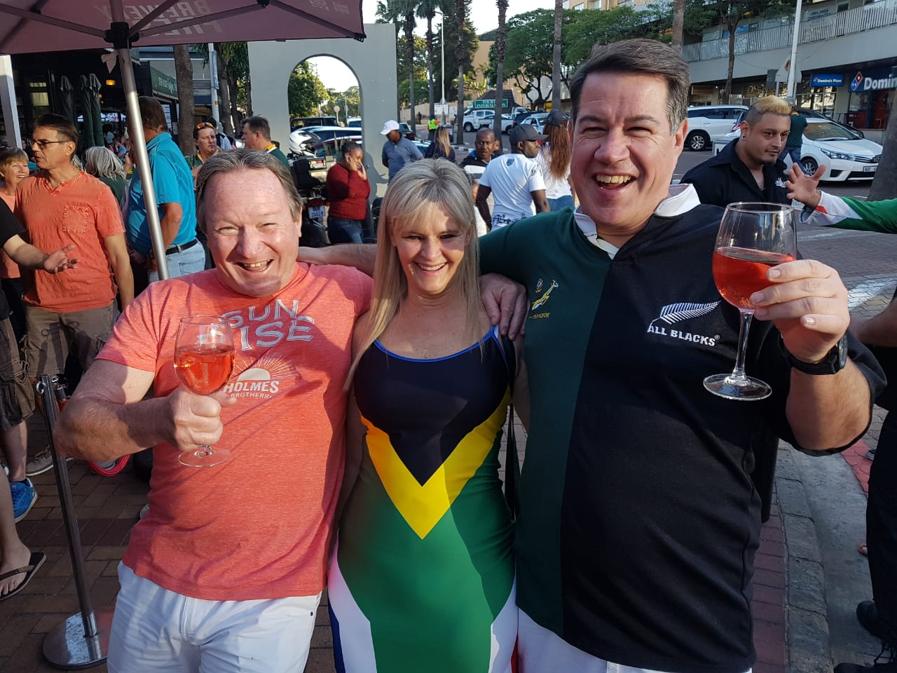FUN IN THE SUN: Rob Rob O Connorman, Liz Van Huysteen and Ross Barber outside The George on matchday. Barber's loyalties seem to be divided.