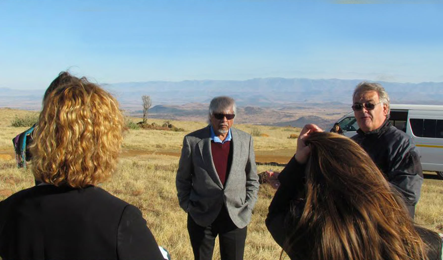 Tour guide Greg Garson and Gandhi grandson at Spioenkop