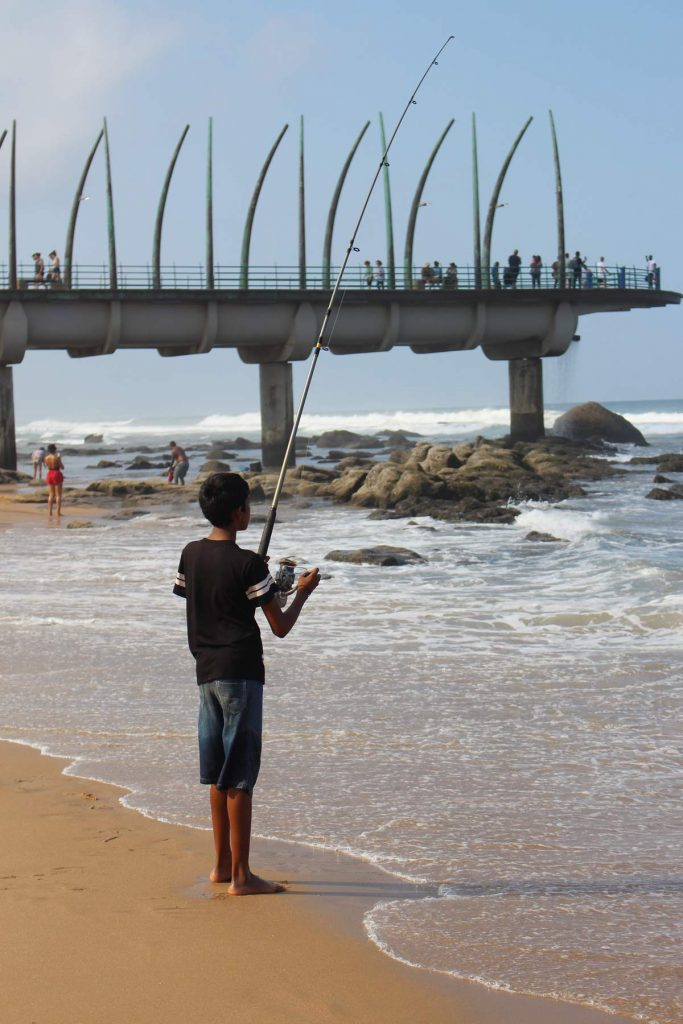 Umhlanga pier fishing boy